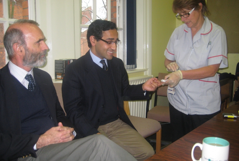 dr_scobie_with_rehman_chishti_as_he_gets_his_blood_glucose_checked.jpg