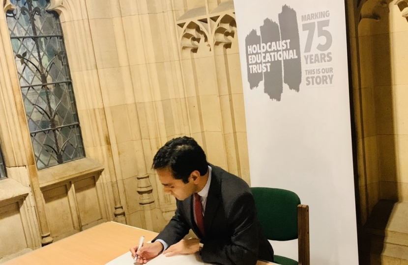 Rehman signing the Book of Commitment