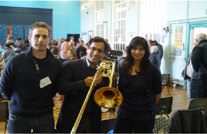 Rehman with Mr Cross (Deputy Head and band member) and Mrs Slade (Head Teacher)